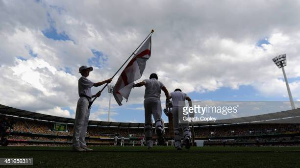 Joe Root and Alastair Cook of England run out to bat during day four of the First Ashes Test match between Australia and England at The Gabba on...