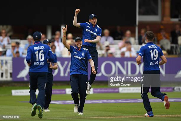Joe Root and Alex Hales of England celebrate the wicket of Azhar Ali of Pakistan during the 2nd One Day International match between England and...