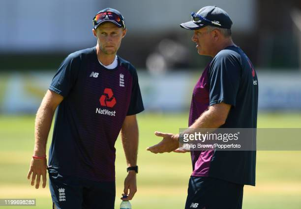 Joe Root and Chris Silverwood of England talk during a training session at St George's Park before the third Test Match between England and South...