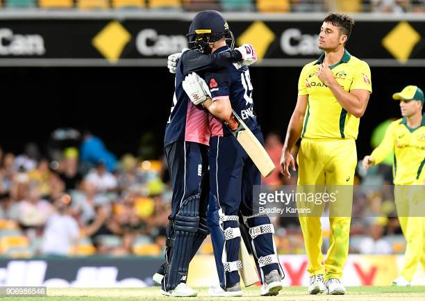 Joe Root and Chris Woakes of England celebrate victory after game two of the One Day International series between Australia and England at The Gabba...