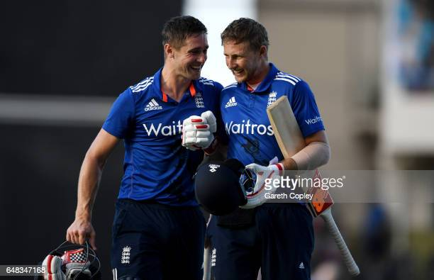 Joe Root and Chris Woakes of England celebrate winning the 2nd One Day International match between the West Indies and England at Sir Vivian Richards...
