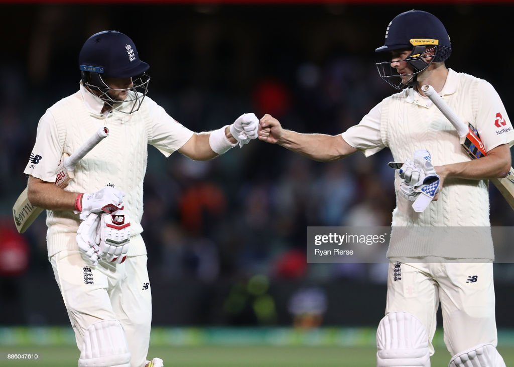 Joe Root and Chris Woakes of England leave the ground at stumps during day four of the Second Test match during the 2017/18 Ashes Series between Australia and England at Adelaide Oval on December 5, 2017 in Adelaide, Australia.