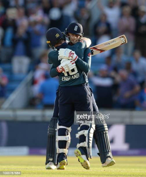 Joe Root and Eoin Morgan of England celebrate hthe win in the 3rd Royal London OneDay International between England and India at Headingley on July...