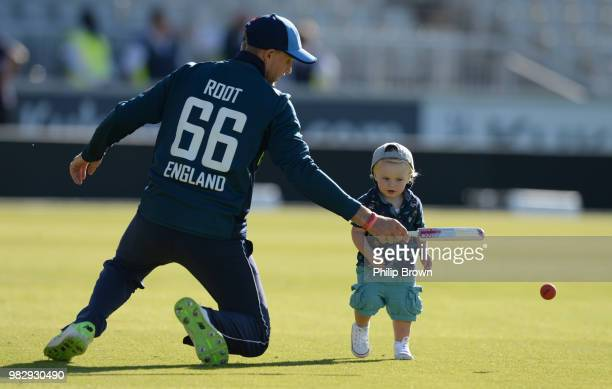 Joe Root and his 17 month old son Alfred play on the field after the fifth Royal London One-Day International match between England and Australia at...