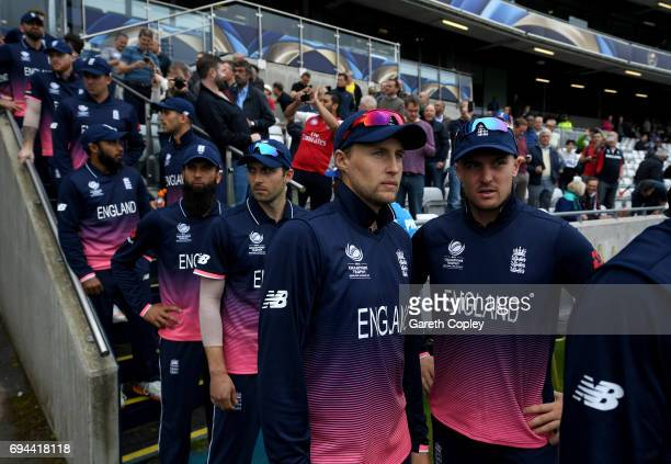 Joe Root and Jason Roy of England lines up with teammates ahead of the ICC Champions Trophy match between England and Australia at Edgbaston on June...