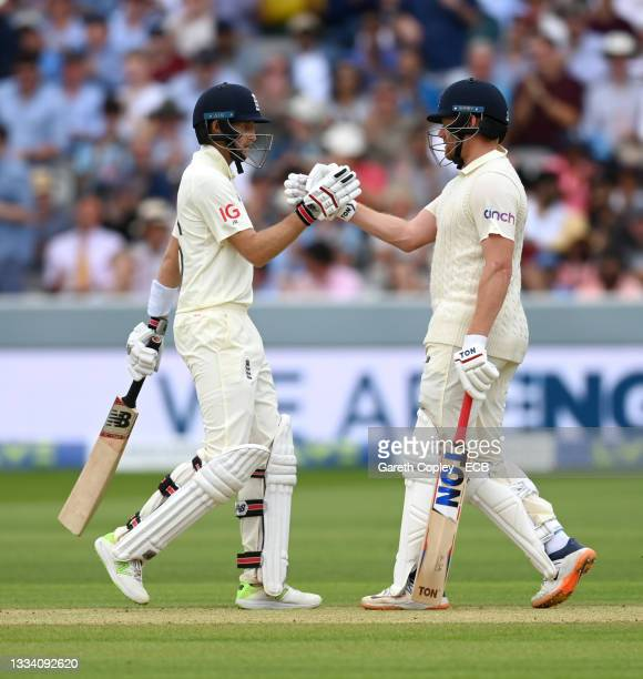 Joe Root and Jonathan Bairstow of England shake hands after reaching their 100 partnership during day three of the Second LV= Insurance Test Match...