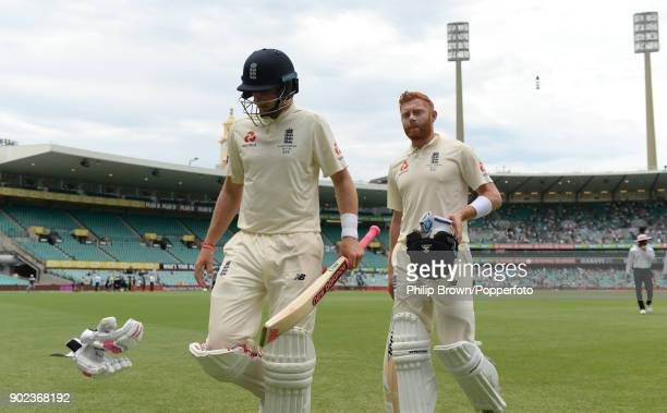 Joe Root and Jonny Bairstow of England leave the field for lunch during the fifth day of the fifth Ashes cricket test match between Australia and...