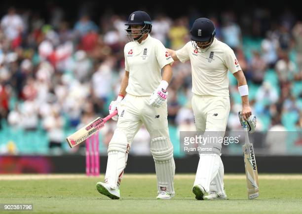 Joe Root and Jonny Bairstow of England walk form the ground at lunch during day five of the Fifth Test match in the 2017/18 Ashes Series between...