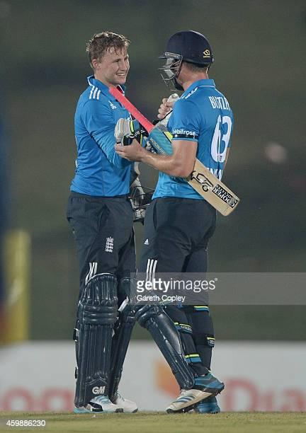 Joe Root and Jos Buttler of England celebrate after winning the 3rd One Day International between Sri Lanka and England at Mahinda Rajapaksa...