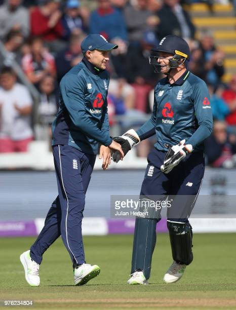 Joe Root and Jos Buttler of England celebrate the wicket od DâArcy Short of Australia during the 2nd Royal London ODI match between England and...