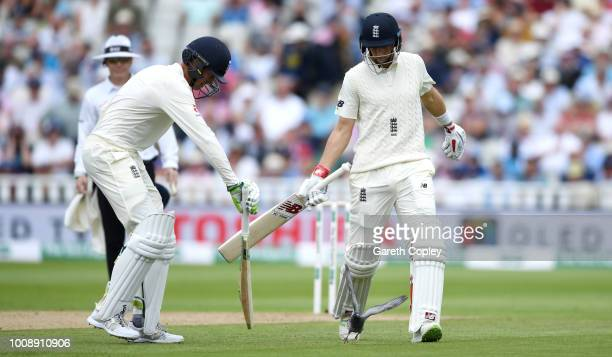 Joe Root and Keaton Jennings of England try to usher away a pigeon during the Specsavers 1st Test between England and India at Edgbaston on August 1...