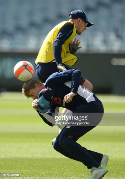 Joe Root and Mason Crane of England clash as they play football during a net session before the fourth Ashes cricket test match between Australia and...