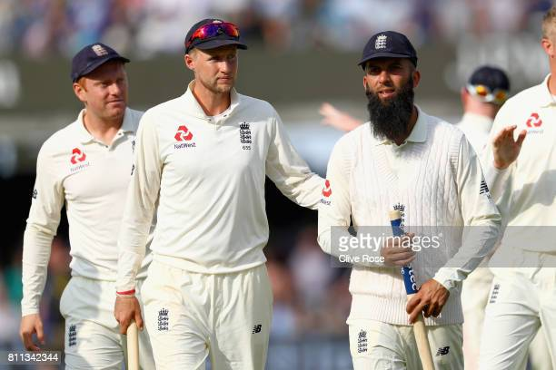 Joe Root and Moeen Ali of England leave the field after England win the1st Investec Test match between England and South Africa at Lord's Cricket...