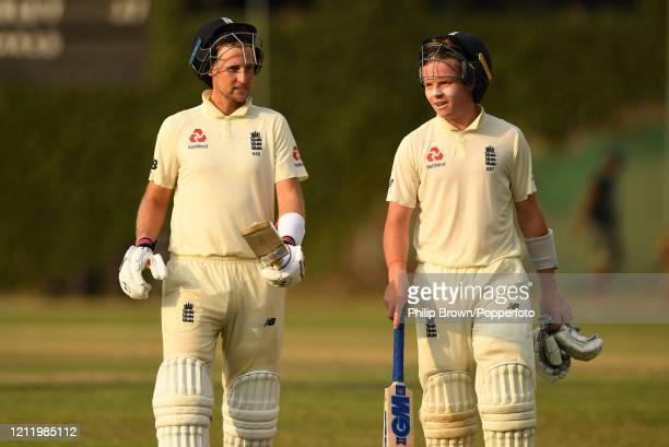 Joe Root and Ollie Pope of England leave the field at stumps after the first day of the match between a Sri Lanka Board President's XI and England at...