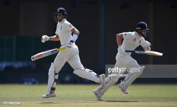 Joe Root and Ollie Pope of England run between the wickets during the tour match between SLC Board President's XI and England at P Sara Oval on March...