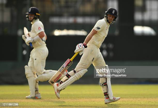 Joe Root and Ollie Pope of England run during the match between a Sri Lanka Board President's XI and England at P Sara Oval on March 12 2020 in...