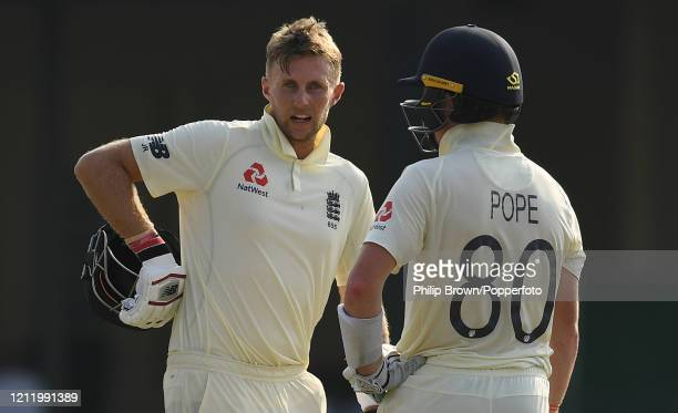 Joe Root and Ollie Pope of England talk during the match between a Sri Lanka Board President's XI and England at P Sara Oval on March 12 2020 in...