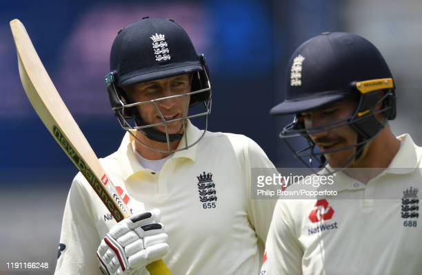 Joe Root and Rory Burns of England leave the field for the lunch break during day 3 of the second Test match between New Zealand and England at...