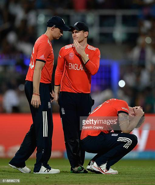 Joe Root captain Eoin Morgan and Ben Stokes of England react after losing the ICC World Twenty20 India 2016 Final between England and the West Indies...