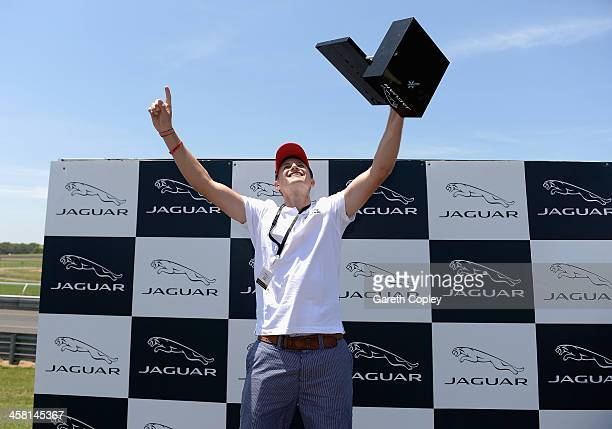 Joe Root celebrates after winning the players challenge during a Jaguar test drive day at Sandown International Motor Raceway on December 20 2013 in...