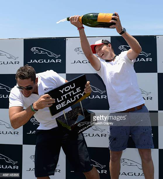 Joe Root celebrates alongside last placed Tim Bresnan after winning the players challenge during a Jaguar test drive day at Sandown International...