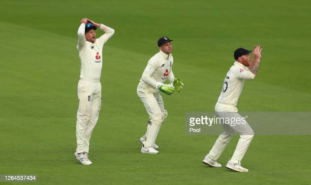 Joe Root Jos Buttler and Ben Stokes react during Day Three of the 1st #RaiseTheBat Test Match between England and Pakistan at Emirates Old Trafford...
