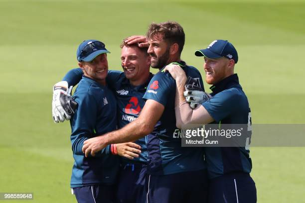 Joe Root Jos Buttler Liam Plunkett and Ben Stokes of England celebrate the wicket of K L Rahul of India during the 2nd Royal London One day...