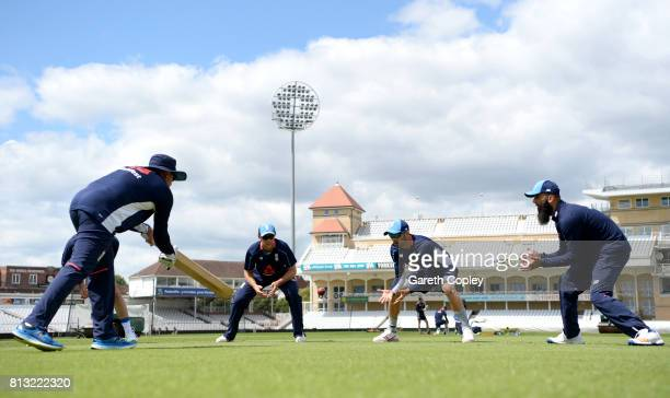 Joe Root Mark Wood and Moeen Ali of England take part in a nets session at Trent Bridge on July 12 2017 in Nottingham England