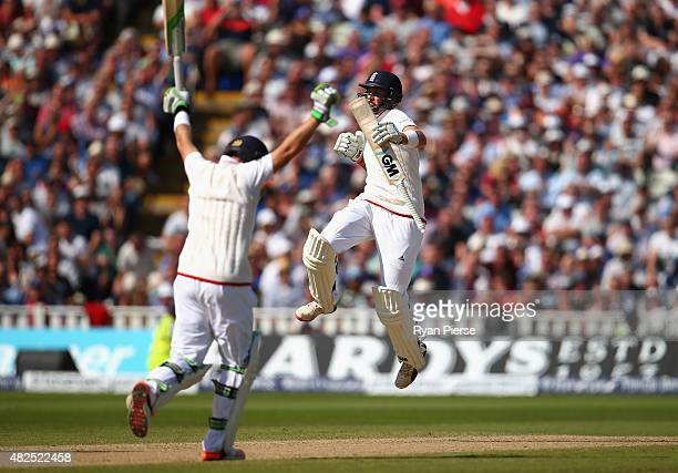 Joe Root of England and Ian Bell of England celebrate after scoring the winning runs during day three of the 3rd Investec Ashes Test match between...