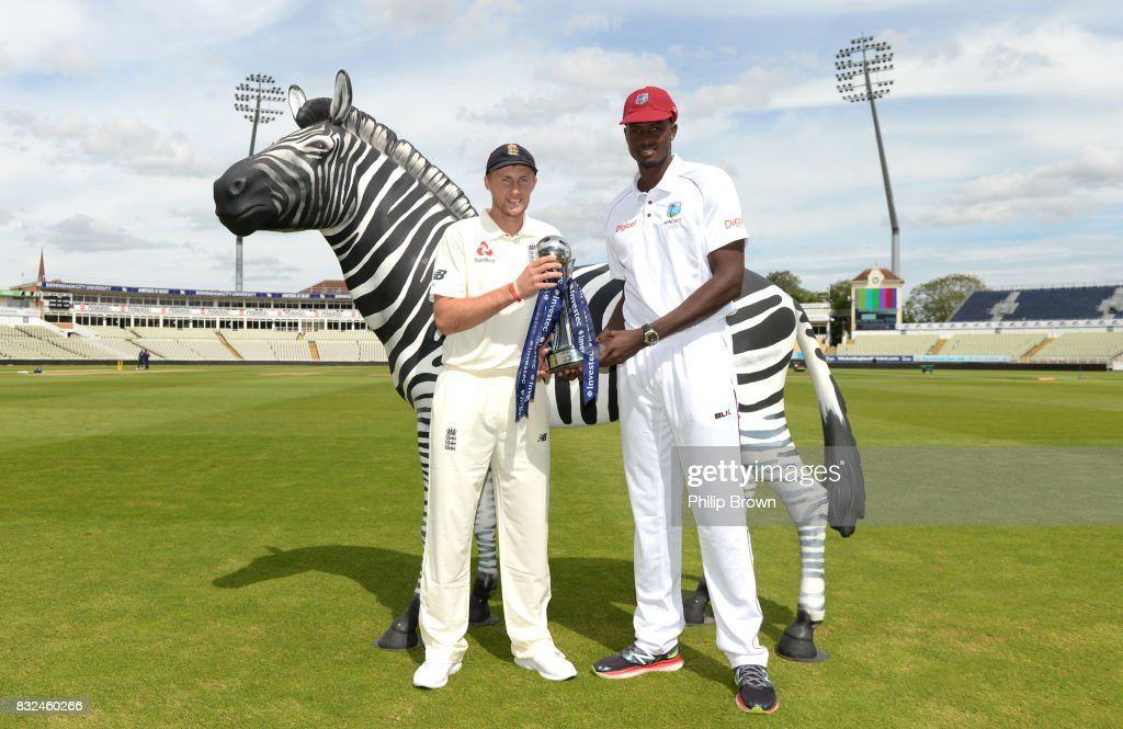Joe Root of England and Jason Holder of the West Indies pose with both the series trophies before the 1st Investec Test match between England and the West Indies at Edgbaston cricket ground on August 16, 2017 in Birmingham, England.
