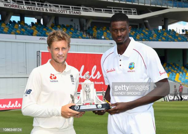 Joe Root of England and Jason Holder of West Indies hold the Wisden trophy one day ahead of the 1st Test between England and West Indies at...