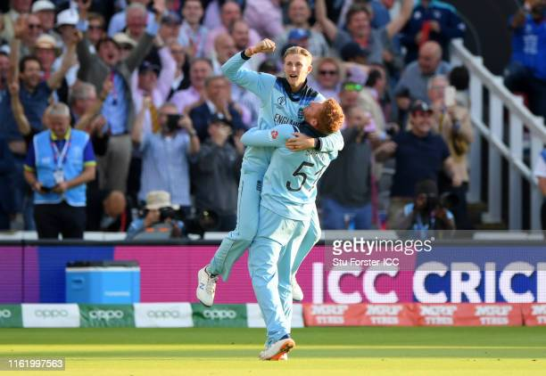 Joe Root of England and Jonny Bairstow of England celebrate after winning the Cricket World Cup during the Final of the ICC Cricket World Cup 2019...