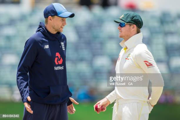 Joe Root of England and Steve Smith of Australia speak while the wicket is dried to to a rain delay during day five of the Third Test match during...