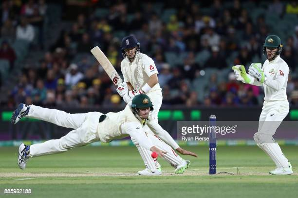 Joe Root of England bats as Cameron Bancroft of Australia attempts to field the ball during day four of the Second Test match during the 2017/18...