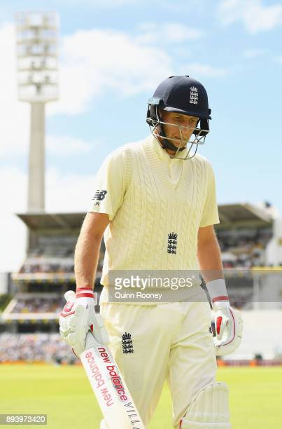 Joe Root of England bats walks off the field after being dismissed by Nathan Lyon of Australia during day four of the Third Test match during the...