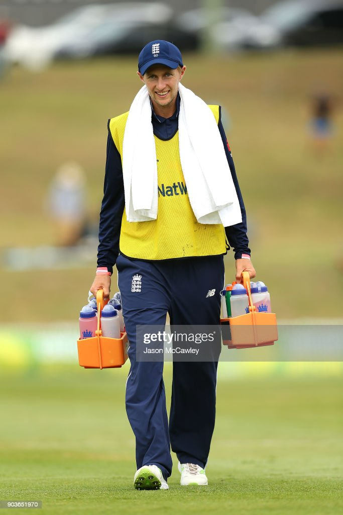 Joe Root of England carries the drinks during the One Day Tour Match between the Cricket Australia XI and England at Drummoyne Oval on January 11, 2018 in Sydney, Australia.