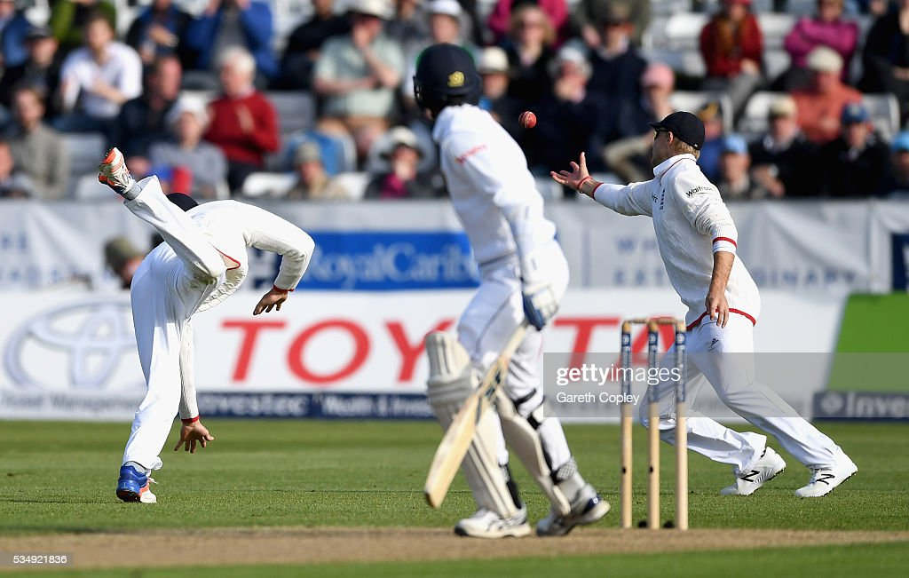 Joe Root of England catches out Shaminda Eranga of Sri Lanka after James Vince parries the ball during day two of the 2nd Investec Test match between England and Sri Lanka at Emirates Durham ICG on May 28, 2016 in Chester-le-Street, United Kingdom.