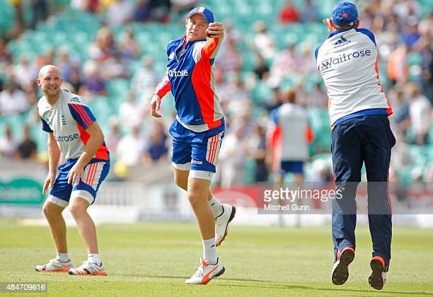Joe Root of England catches the ball as Adam Lyth and Ian Bell look on during the warm up before play on day two of the 5th Investec Ashes Test match...