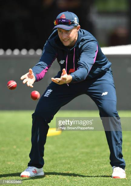 Joe Root of England catches two balls during a training session at Seddon Park before the second test match against New Zealand on November 27, 2019...