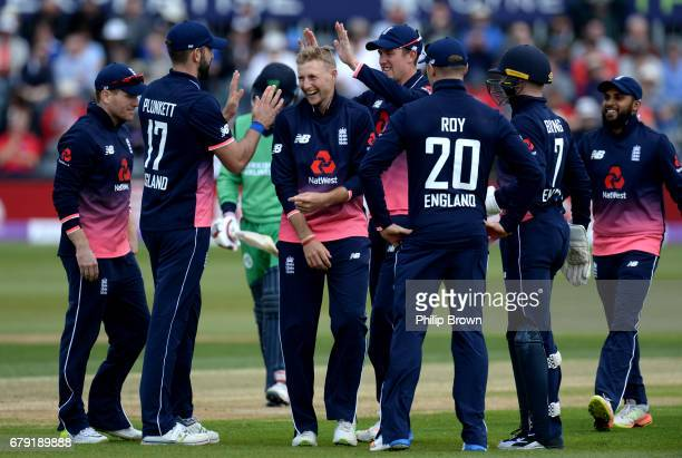 Joe Root of England celebrates after dismissing William Porterfield of Ireland during the 1st Royal London oneday international cricket match between...
