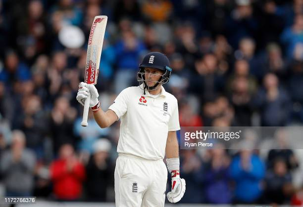 Joe Root of England celebrates after reaching his half century during day three of the 4th Specsavers Test between England and Australia at Old...