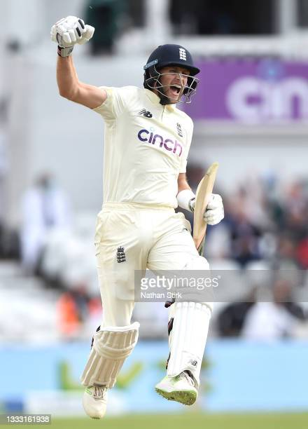 Joe Root of England celebrates after scoring 100 runs during day four of the First Test Match between England and India at at Trent Bridge on August...