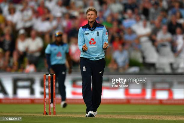 Joe Root of England celebrates after taking the wicket of Quinton de Kock of South Africa during the First One Day International match between South...