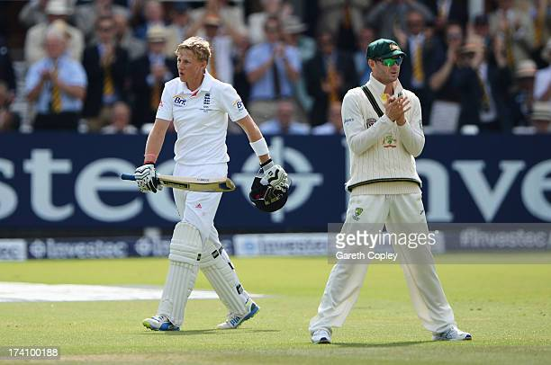 Joe Root of England celebrates his century as Michael Clarke of Australia applauds during day three of the 2nd Investec Ashes Test match between...