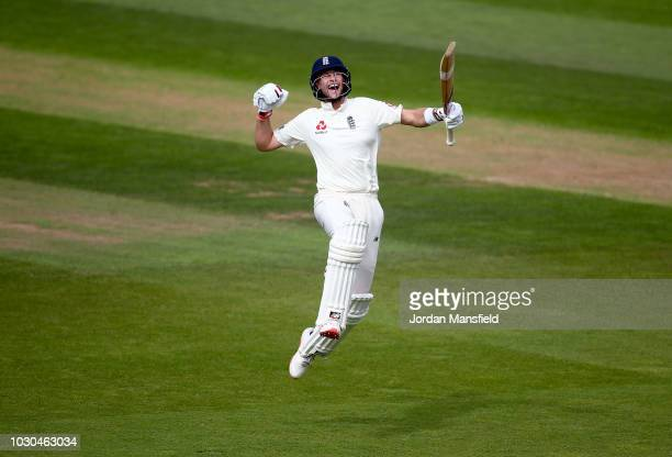 Joe Root of England celebrates his century during day four of the Specsavers 5th Test match between England and India at The Kia Oval on September 10...