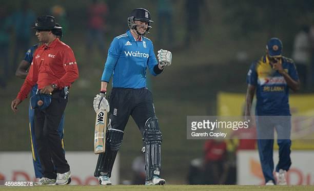 Joe Root of England celebrates hitting the winning runs to win the 3rd One Day International between Sri Lanka and England at Mahinda Rajapaksa...