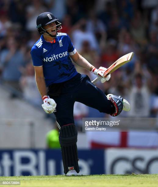 Joe Root of England celebrates reaching his century during the 3rd One Day International between the West Indies and England at Kensington Oval on...