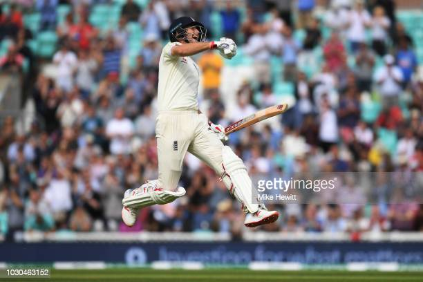 Joe Root of England celebrates reaching his century during the Specsavers 5th Test Day Four between England and India at The Kia Oval on September 10...