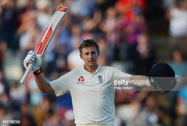 Joe Root of England celebrates reaching his century during the first day of the 1st Investec Test match between England and the West Indies at...