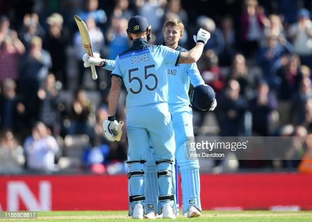 Joe Root of England celebrates reaching his century with Ben Stokes of England during the Group Stage match of the ICC Cricket World Cup 2019 between...